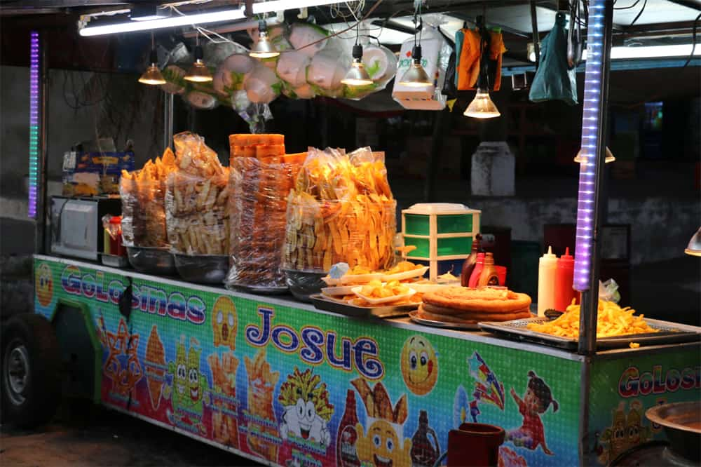 Street food stall with a selection of different fried items.