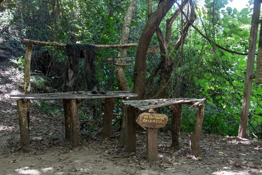 Makeshift beds and tables out of scrap wood in the jungle.
