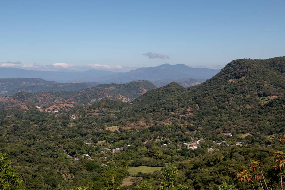 View overlooking a valley and mountain covered in jungle.
